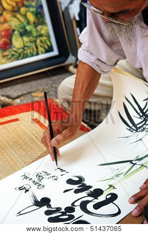 Calligrapher draw handwriting in penmanship