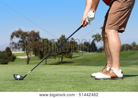 Man playing a game of golf outside