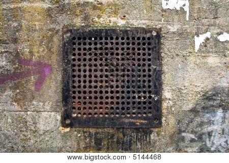 Rusty Metal Air Venti In Concrete Wall