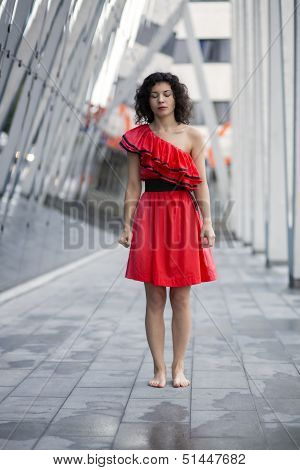 Woman In Red Dress Stand Straight