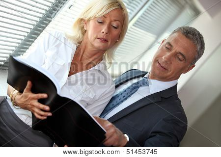 Mature businessman and businesswoman