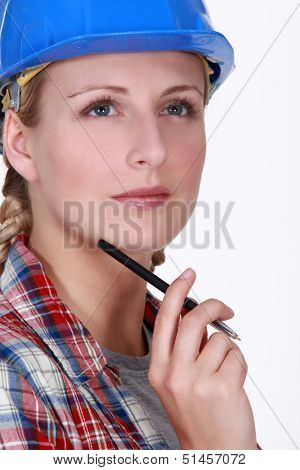 craftswoman holding a pen and thinking