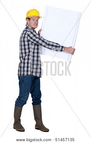 Nervous foreman holding plans