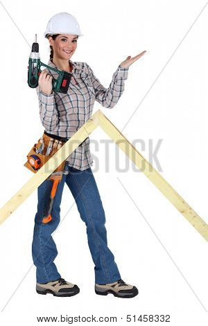 Woman with drill and wooden triangle