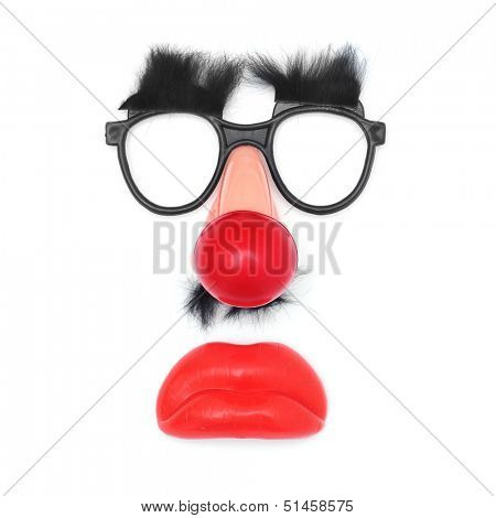funny face: fake glasses and eyebrows, clown nose, mustache and mouth on a white background