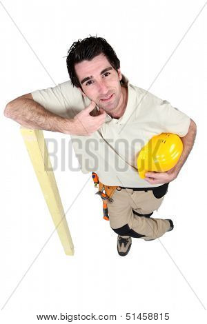 woodworker leaning on a board