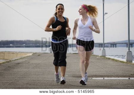 Two Young Women Jogging Together