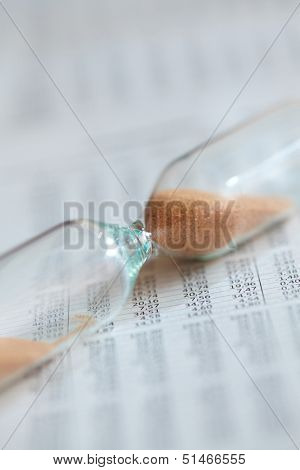 Hourglass on the document