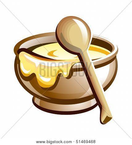 Porridge in the pot with wooden spoon