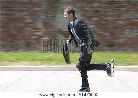 Businessman rollerblading. Concept: go green