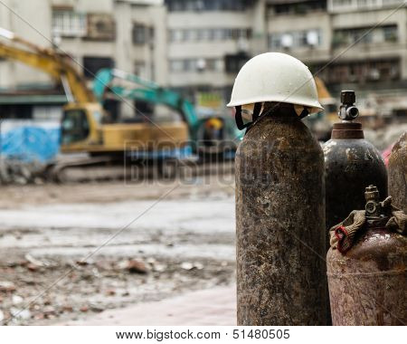 Hardhat On A Gas Cylinder At A Construction Site