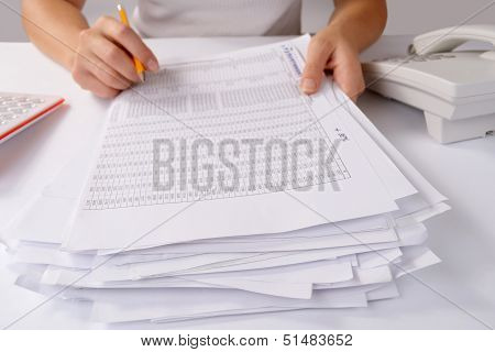 Hands Holding A Batch Of Loose Paperwork
