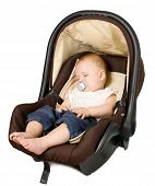 image of seatbelt  - Baby boy is sitting in safety car seat - JPG