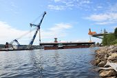 pic of flatboat  - Bridge lift from the bay whith crane on board