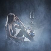 foto of hookah  - Beautiful girl in sexy underwear smoking the hookah - JPG
