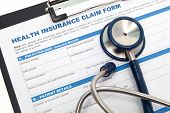 image of submissive  - Medical and health insurance claim form with stethoscope on clipboard - JPG
