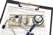 stock photo of reimbursement  - International travel medical insurance application with stethoscope - JPG