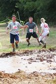 MUSKOGEE, OK - Sept. 14: Zombies attack runners and attempt to grab their red life flags  during the