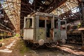 picture of railroad yard  - Cargo trains in old train depot left to be eaten by the rust - JPG