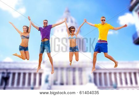 summer, holidays, vacation, happy people concept - group of friends or couples jumping