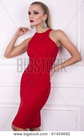 sexy glamour blond woman in elegant red dress