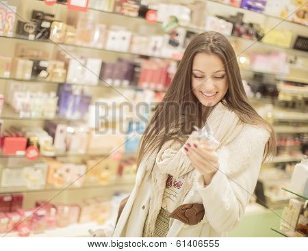 Pretty Young Woman In Perfumery