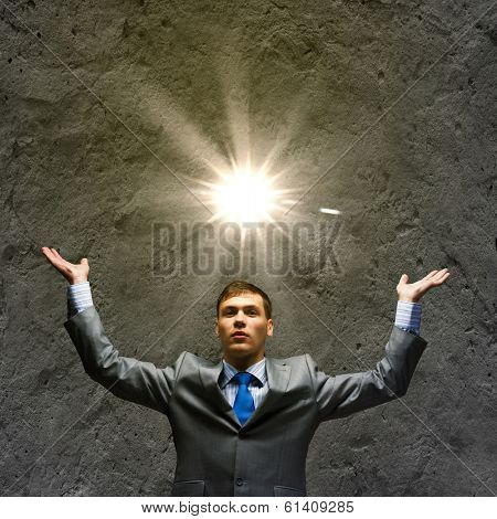Young handsome businessman wit sun shining above head