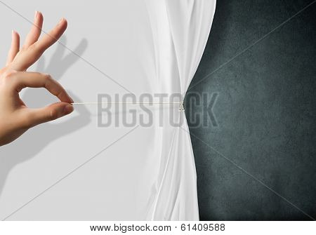 Close up of hand opening the white curtain