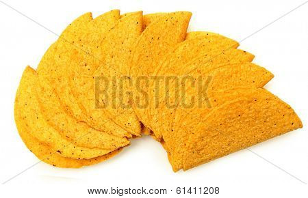 Stack of Crunchy Cornmeal gluten Free Taco Shells over white.