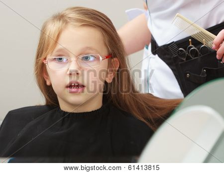 Hairdresser Combing Hair Little Girl Child In Hairdressing Beauty Salon