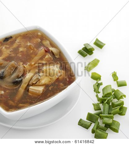 Hot and Sour Soup In A White Bowl