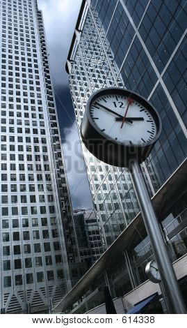 Modern Architecture And Office Buildings Are In The Back An There Is A Street Clock In The Foregroun