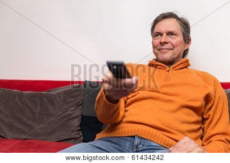 Senior Adult With Remote Control
