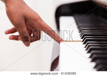 African American Hand Playing Piano - Touching Piano Keys - Black People