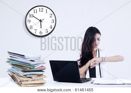 Bored Businesswoman Looking At Watch