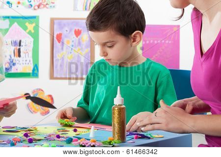 A Boy Playing Creative Colourful Games