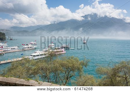 NANTOU, TAIWAN - FEBRUARY 20 : Many tourist people take a trip by boats at the lake of famous attraction, Sun Moon Lake at Taiwan on february 20, 2013 in Nantou county, Taiwan, Asia.