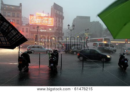 PARIS, FRANCE CIRCA AUGUST 2006 - Rainy early evening in front of the Moulin Rouge