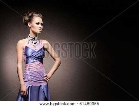 Portrait of young, attractive and gorgeous woman in jewels over luxury background