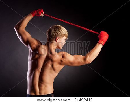 Young Boxer fighter on studio