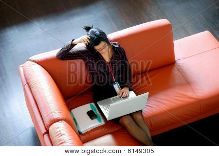 Worried Woman On Couch Tilted