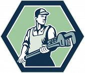 picture of plumber  - Illustration of a plumber with plumbing monkey wrench set inside hexagon facing front done in retro woodcut style on isolated background - JPG