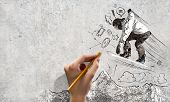 image of snowboarding  - Close up of hand drawing sketches of snowboarder - JPG