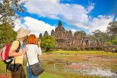Couple at  Prasat Bayon temple,  Angkor Thom, near Siem Reap, Cambodia.