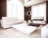 Modern interior design, white&brown colors in flat interiors, luxury sofa and table with little plan