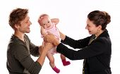 foto of bye  - Business woman and mother handing child to stay at home father  - JPG
