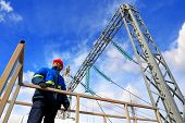 image of substation  - The electrician examines the equipment of electric substation - JPG