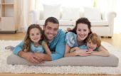 Family On Floor In Living-room