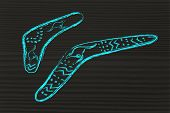 foto of boomerang  - funny design of two australian boomerangs the hunting tools that comes back metaphor of cause - JPG