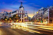 image of street-art  - Rays of traffic lights on Gran via street main shopping street in Madrid at night - JPG